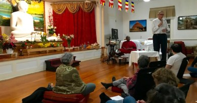 Neal Cichanowicz of Northville shared his thoughts at Tuesday's meditation session, while Bhante Kottawa Nanda (in orange robes) looked on.