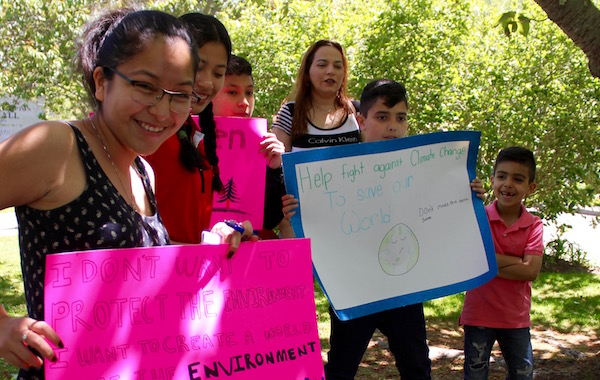 Student Ashley Ambrocio (at left) with a group of young citizens concerned about climate change.
