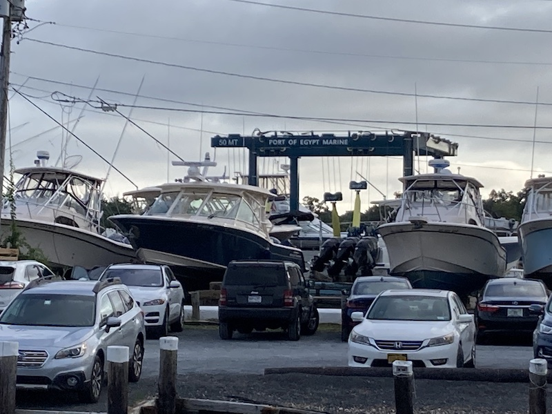 Taking boats out of the water at Port of Egypt in Southold