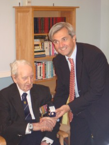 Mr Gerrard receives his Veterans Badge from Chris Huhne