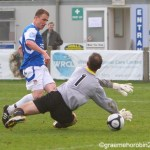 Tony Taggart slips the ball past the keeper for a brace