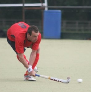 Chris Gittens making a pass that cuts through the opposition defence