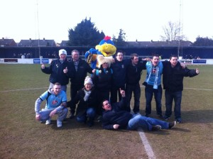 Eleven brave Eastleigh fans on the pitch at The Camrose Stadium