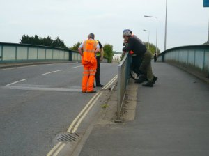 Engineer and police assess damage