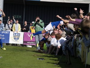 Striker Ben Wright crowd surfs after scoring Eastleigh's second (photo by Tony Smith)