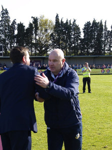 Manager Richard Hill receives his winners medal