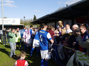 Eastleigh fans celebrating with players after winning the league