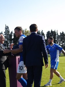 Ben Wright receiving his winners medal (Photo by Tony Smith)
