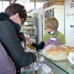 Customer paying at shop counter