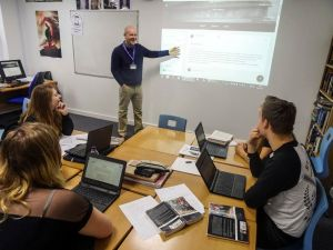 Teacher Mark Robinson leading his lesson with Google Classroom and students engaging with Google Classroom methods