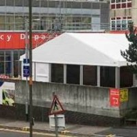 Hospital erects marquee to triage coronavirus patients