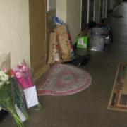 Floral tributes and forensic evidence outside Irene Barrett's flat. Photo: Thuto Mali.