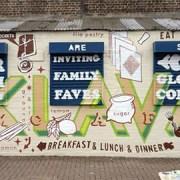 A Gourmandizing mural by Matthew McGuinness in Brixton.