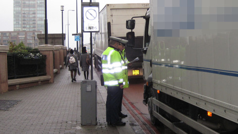 Officers inspect a lorry. Pic: Met Police