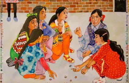 Girls playing Ful Ti Bengali Five Stones game in Bangabandhu Primary School Bethnal Green Pic: Dan Jones