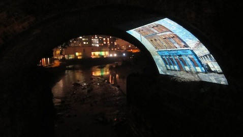 Fasching's short film projected onto an archway beneath railway tracks Pic: Jessica Chia