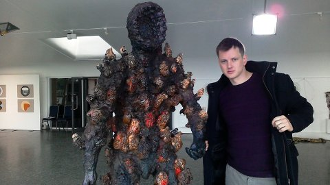 Artist Benjamin Ellingsen with his sculpture Place where Jesus was for three days. Pic: Between Faith and Art Exibition