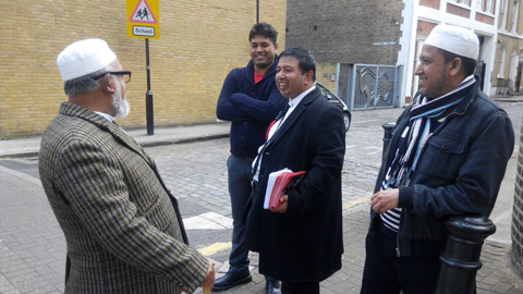 Labour Party member leafletting in Tower Hamlets