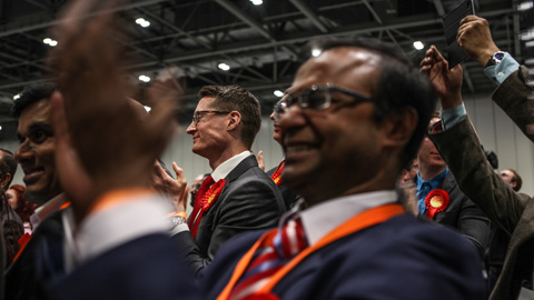 Labour party supporters cheer as the results of the Tower Hamlets mayoral race are declared. Pic: Kara Fox