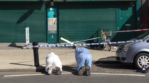 Police forensic officers at the scene of the crime. Pic: Alex Sturrock