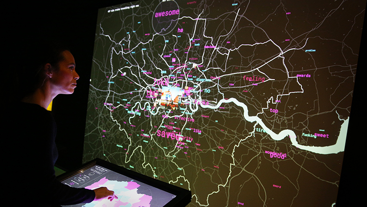 A staff member interacts with a live social media map of London at the Big Bang Data exhibition at Somerset House. Pic: Peter Macdiarmid/Getty Images