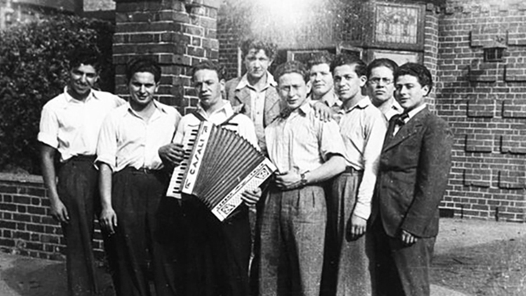 A group of nine young men outside the hostel in Nightingale Road, Clapton, North London. Pic: The Jewish Museum