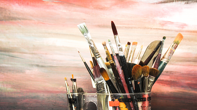 Paintbrushes lie about in Yi-Ling's studio. Picture: Naomi Seow