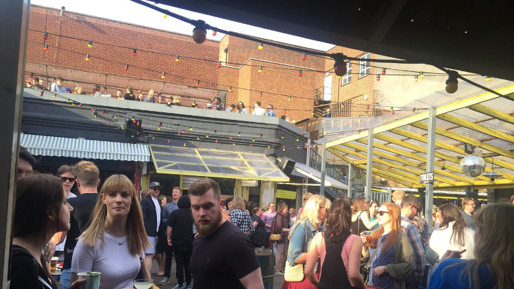 People enjoying the sun at the Street Feast. Pic: Michelle Aigbogun
