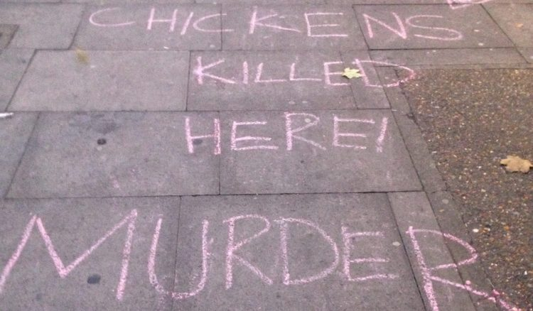 Protestors chalked slogans on the pavement