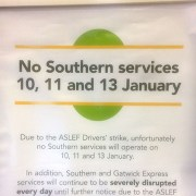 Notice board at New Cross Gate station alerting commuters of strikes.