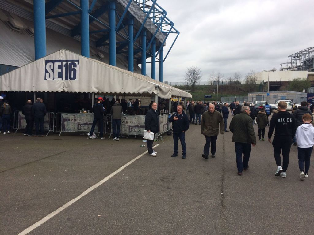 The club sets up a gazebo outside the reception where fans drink and catch up