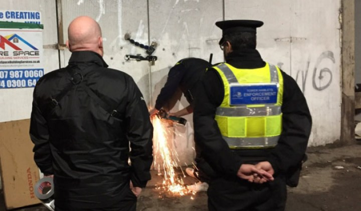 Bailiffs and council enforcement officers bust into illegal shack under Fenchurch Street railway.