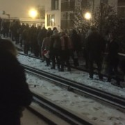 Passengers walking along snow-covered train tracks in Lewisham. Pic: Nina Bevan @ninaEbevan