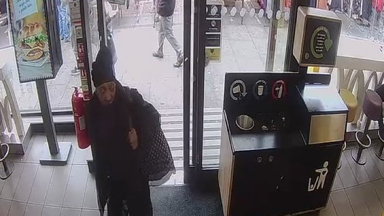 This picture shows a still from CCTV taken in McDonalds on the day the assault occurred.
