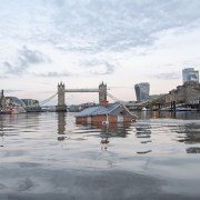 The future? Earlier this month Katey Burak and Rob Higgs from Extinction Rebellion installed a sinking house into the Thames as a protest against current planning by councils Pic: Guy Reece
