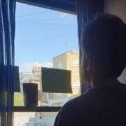 Man by window