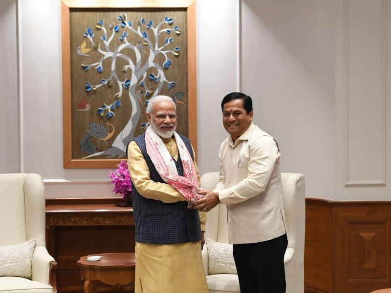 Modi reshuffles Cabinet; Sonowal, Scindia brought in