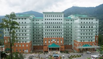 The COVID section is located below the main nine-storey tall STNM Hospital building