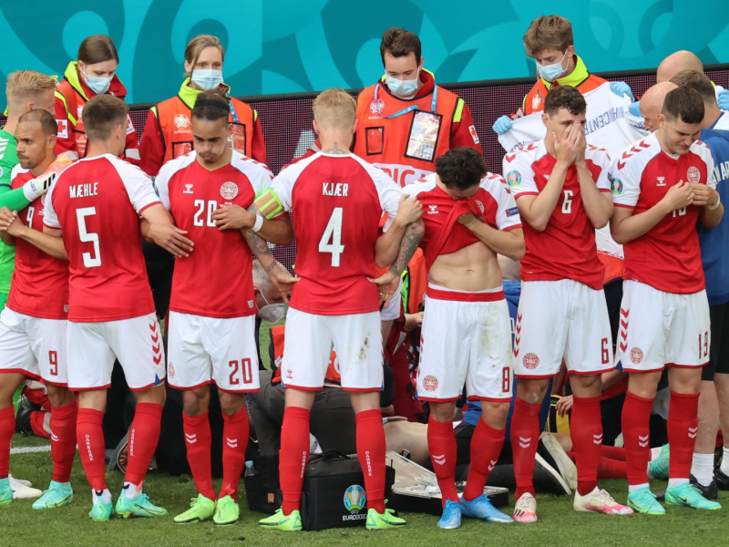 Denmark's Christian Eriksen collapses on pitch, players in tears