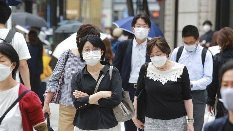 Japan extends virus emergency until end of September