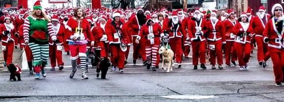 """Holiday season kicks off with """"red wave"""" Santa Run downtown"""