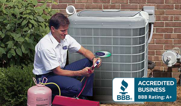Repairman fixing Carrier AC unit Tampa AC Repair