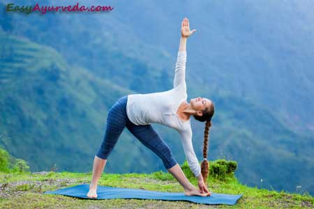 trikonasana triangle pose how to do benefits side effects