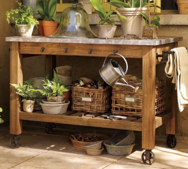 rustic wood potting bench with wheel