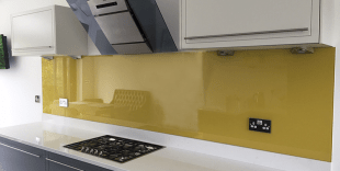 BY9 Mustard Yellow coloured glass splashback with grey wall cupboards