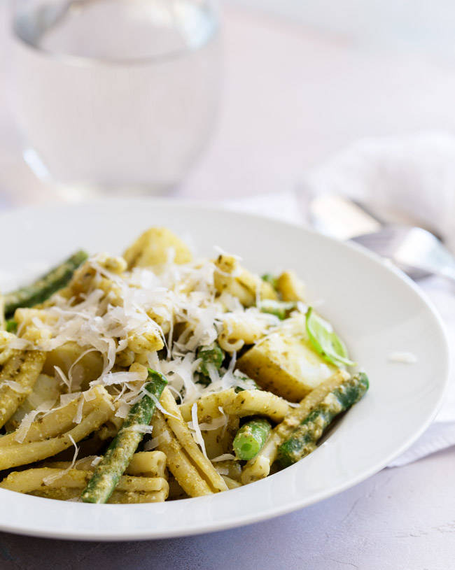 Pasta Genovese, is a pesto dressed pasta with new potatoes and green beans. It is classic Ligurian dish where everything is cooked together in the same pan, making it a great one pot pasta, perfect for a mid-week meal. From Easy Pasta Sauces.