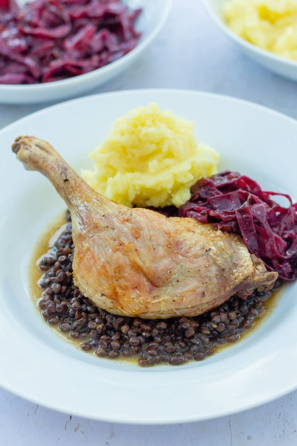 Roast duck on a bed of Puy lentils, served with braised red cabbage and buttery mash.