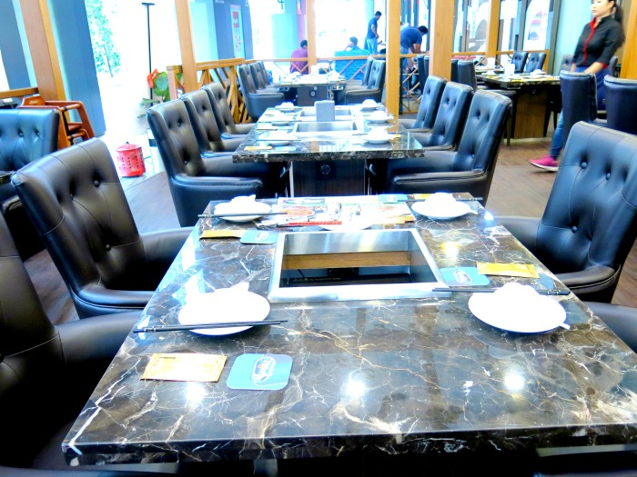 Hai Xian Lao Marble Table and Leather Chairs