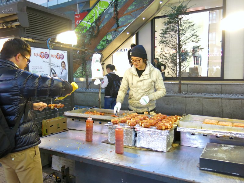 Evan eating street food at Myeongdong