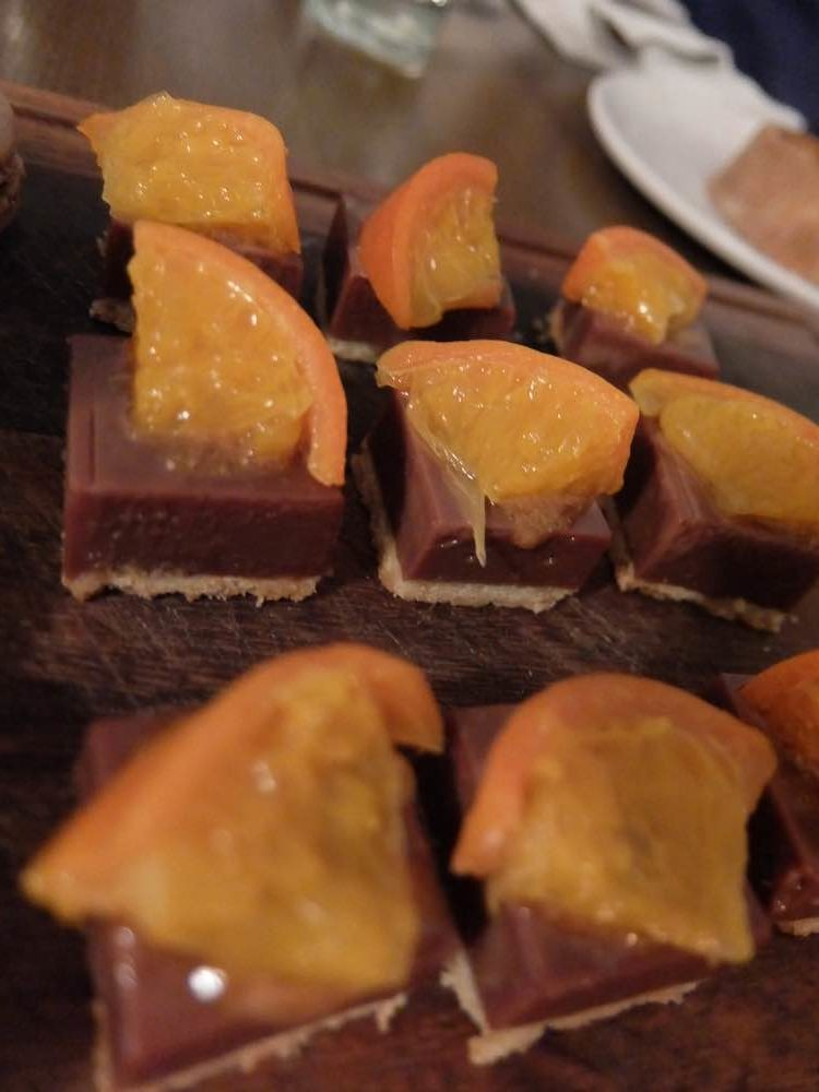 Milk Chocolate Tart with Hazelnut Praline and Candied Clementine – an absolute treat!